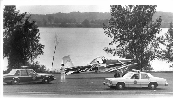 Airplanes - Cessna<br /> 22 year old pilot William A Salton of St. Catherines, Ont. was forced to make an emergency landing in his single engine Cessna between Niagara River and Robert Moses Pkwy. near 4th Street enterance.<br /> Photo - By L. Massey - 9/6/1987.