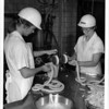 Food - Hot Dogs<br /> Stuffing the hot dog casing as the emulsion comes from the stuffing compression are Peggy Stachowiak and Pearl Imbirowicz.<br /> Photo - By Andrew J. Susty - 7/13/1978.