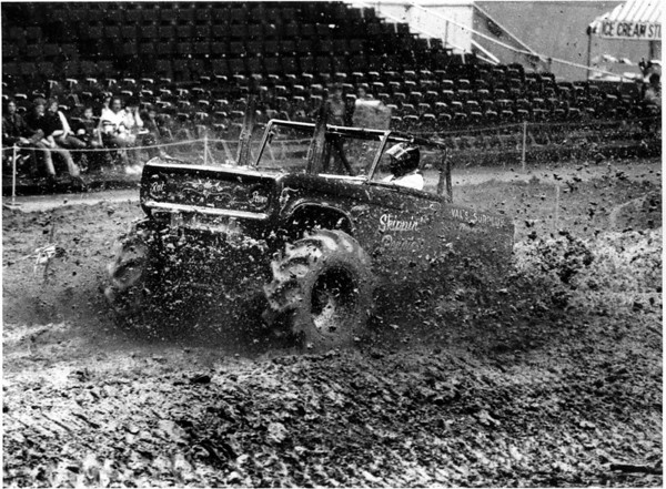 "Convention Center - Bookings<br /> Monster Truck Show<br /> Skip Collins is ""Skippin Pennies"" from Plaistow, New Hampshire in the Open Mud racing Division.<br /> Photo - By Ron Schifferle - 9/19/1986."