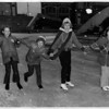 Convention Center Plaza<br /> First 4 skaters on the ice .<br /> To open Lackey Plaza Skating Rink.<br /> Photo - By Andrew J. Susty - 12/31/1980.