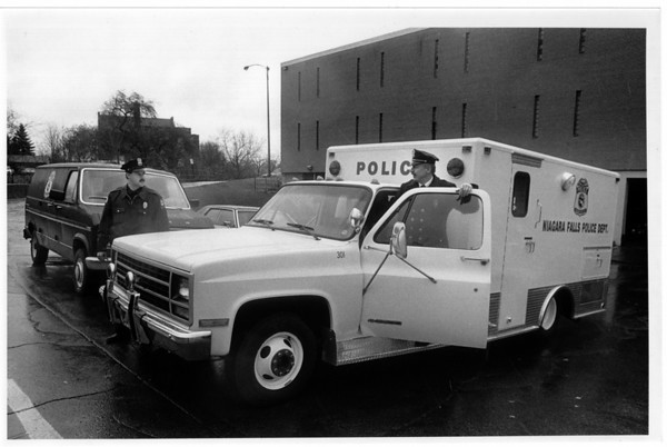 Police - Niagara Falls police Dept. <br /> From left to right Officer Christopher Calvano and Lt. Richard Kubik show off the new paddy wagon, the old wagon is to the left of the new one.<br /> Photo - By James Neiss 11/16/1989.