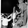 Niagara River - Rescues<br /> Sgt. James Dugos - assists some of the passengers from the Police Boat to the docks of the LaSalle Yacht Club.<br /> Photo - By Andrew J. Susty - 7/11/1977.