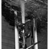 Fires - Niagara Falls<br /> Firefighter Tom Colangelo, of Engine #3, works out of a 2nd story window to put out fire under the eves of a 3 story home at 713 Walnut Ave. Niagara Falls.<br /> Photo - By James Neiss - 11/4/1991.