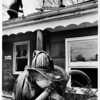 Fires - North Tonawanda<br /> 288 Old Falls Blvd. North Tonawanda Fires.<br /> Paul Martin of Sweeney Hose takes a drink from a leaky connection.<br /> Photo - By Bob Bukaty - 3/28/1984.