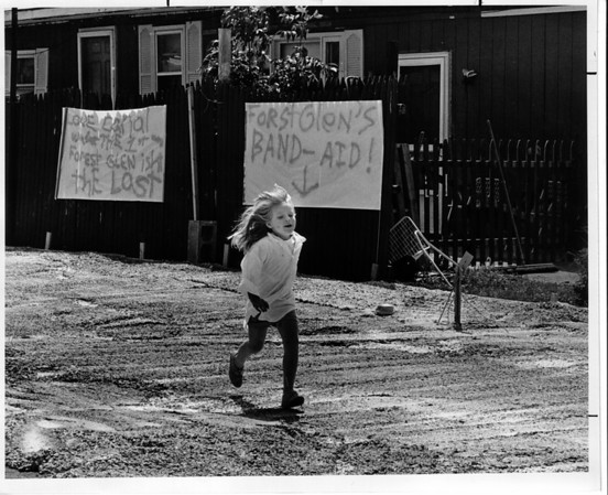 Forest Glen - Toxic Waste<br /> 4 year old Shauna Freiermuth of Carrie Drive on the poured concrete next to her trailor home. It was put there to cover exposed waste. With sign in the background.<br /> Photo - By Ron Schifferle - 7/28/1989.