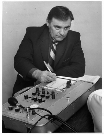 police Niagara County Sheriffs Dept. Investigator John Cole -Certified Polygraph operator - operates a Polygraph machine - ( Lie Detector Machine).<br /> Photo - By Andrew J. Susty 1/17/1980.