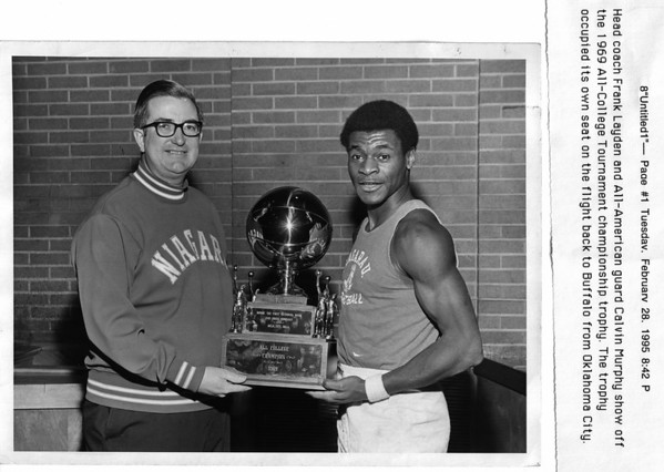 Sports Head coach Frank Layden and All-American guard Calvin Murphy show off the 1969 All-College Tournament championship trophy. Niagara University.