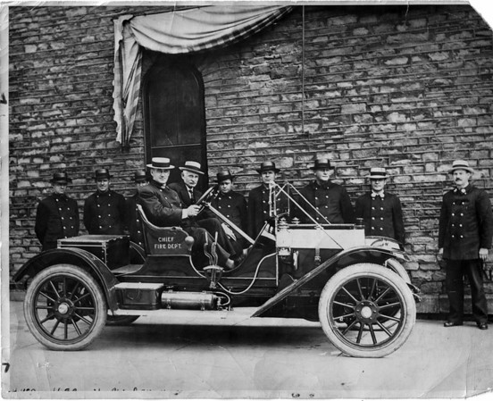 Fires - Niagara Falls<br /> Niagara Falls Fire Department.<br /> Haynes Car Dayton Airless Tires.<br /> James Green, H. McDonald, E. Cassiby, Chief Otto Utz, Mayor Phillip J. Keller, J. Ellis, Geo. Steve, James Keowgh, Captain Power 2nd Assistant Chief Miller.<br /> Photo -By Niagara Gazette - 1910.