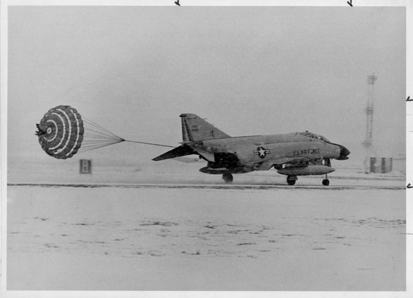 Airplanes - F-104<br /> F-104 landing using a drag chute.<br /> Photo - Ron Schifferle - 1/27/1984.