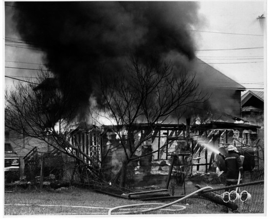 Fires - niagara Falls<br /> Niagara Falls Firefigters battle a garage behind 509 - 511 5th Street Niagara Falls.<br /> Right - fire fighters Randy Walk and Dave Donovan of the 10th Street Firehouse.<br /> Photo - By James Neiss - 1/6/1992.