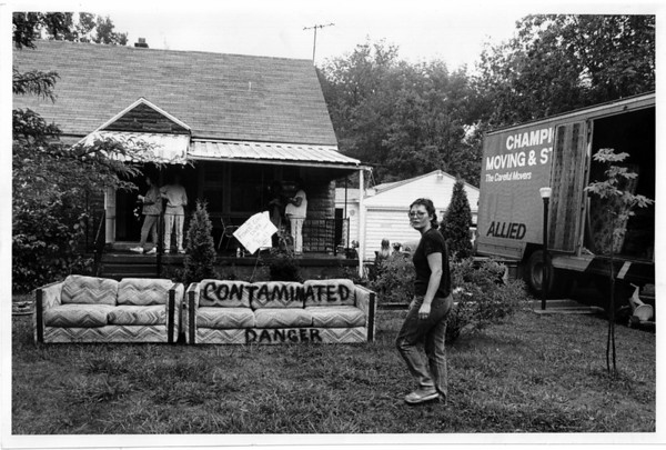 Glen Forest - Toxic Waste<br /> Moving out of Forest Glen Terry Bauer in front of her house on Edgewood Drive with her living room couch that she spray painted. <br /> (Note: She can not take the furniture with her)<br /> Photo - By Ron Schifferle - 9/1/1989.