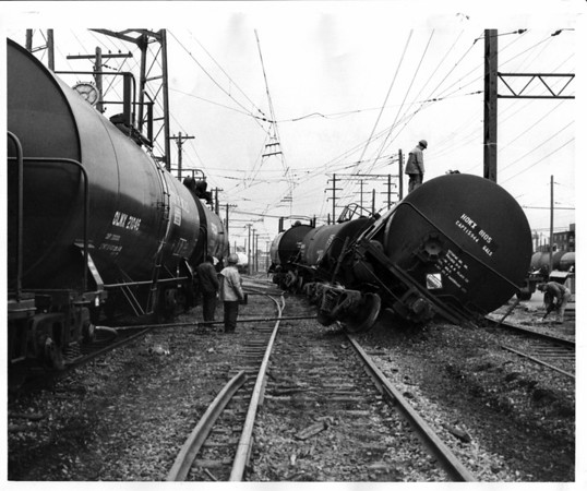 Industries - Dupont<br /> Derailed tank car.<br /> Photo - By L. C. Williams - 4/4/1979
