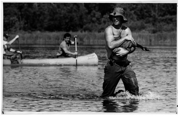 Environmental - Wildlife<br /> On Goose Pond, David Cliffel from Rochester carries this younf goose to the hole-dug area.<br /> Photo - By Ron Schifferle - 7/3/1991.