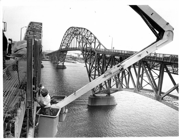 Transportation - South Grand Island Bridge<br /> Lou Di Sarno hangs over the Niagara River while he tightens bolts on a railing on the South Grand Island Bridge.<br /> Photo - By John Kudla - 5/30/1985.
