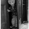 Holidays - Halloween<br /> Robert Howard Jr. age 4 of 2210 McKenna Ave Coming out of Niagara Street School.<br /> Photo - By John Kudla - 10/29/1982.
