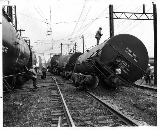 Industries - Dupont<br /> Derailed tank car.<br /> Photo - By L. C. Williams - 4/4/1979.