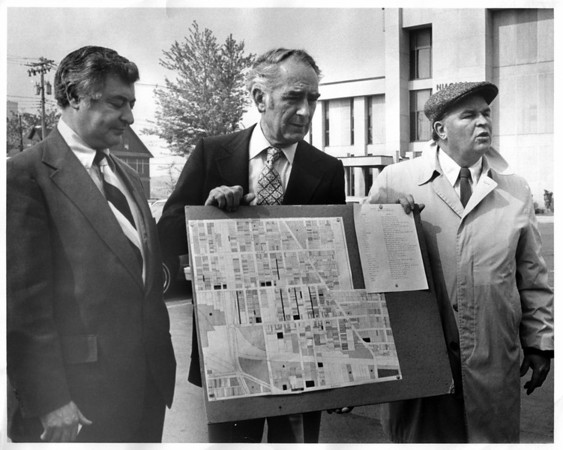 Urban Renewal<br /> Harvey Albond, Mayor O'laughlin and Tony Surace, plans for a new store.<br /> Photo - By L. C. Williams - 5/30/1979.