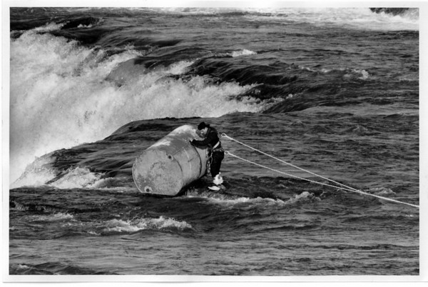 Niagara Falls, Barrel - Removing large barrel from American Falls, Gary Shore, a diver from Emark Industries Inc. of Orchard Park is hooking cable to barrel. 12/12/1990 Ron Schifferle Photo