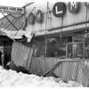 Blizzards - 1977<br /> Th blizzard of 1977.<br /> Damage to Slipkos<br /> Photo - By Niagara Gazette - 2/5/1977.