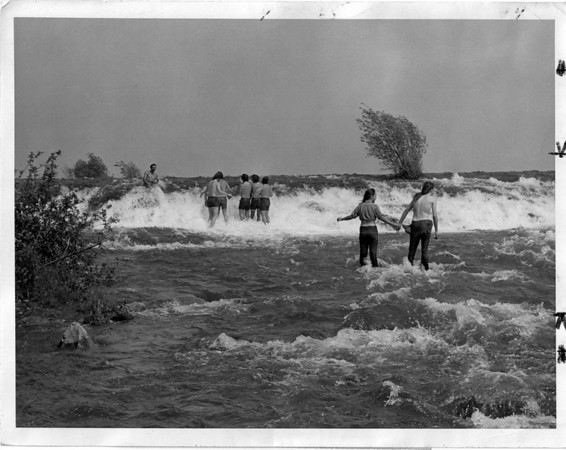 Upper Niagara, Rapids - Tourists venture into the rapids off of Three Sisters Island off Goat Island. July 27, 1975