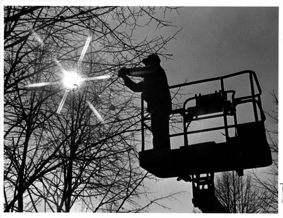 Christmas - Festival of Lights<br /> 1985 Festival of Lights.<br /> Triming the Sun.<br /> Joseph Daniels, City Parks Department. triming the trees in E. Dent Lackey Plaza for the Festival of Lights.<br /> Photo - By Ron Schifferle - 11/8/1985.