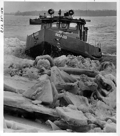 Niagara River, Power Authority, Ice Breaker - The NYS Power Authority Ice Breaker breaking up the ice near the water intakes on the Robert Moses Parkway. The Niagara Queen in background. 1/6/1984 Ron Schifferle Photo