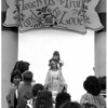 Convention Center Plaza<br /> Sixth Annua Rosary Crusade in Lacky Plaza.<br /> Amy Failinger is placing crown of roses on statue of Mary.<br /> Photo - By Tim Johnson - 9/21/1986.