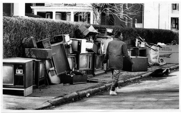 Junk - Niagara Falls<br /> On 13th Street at Niagara Street old tv sets block the side walk.<br /> (Note: The women did not want her name used)<br /> Photo - By Ron Schifferle - 3/23/1990.