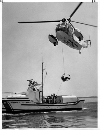 Coast Guard - Lake Ontarion<br /> 5 Miles out into Lake Ontario off Fort Niagara - Under Direction of Boatswain mate Chief C. R. Schmidt - Commanding Oficer. <br /> Helicopter Pilot Lt. Commander Steve Rottier out of the Detroit C.G. Base.<br /> In Hoisting Basket - Boatswain mate 3rd class Joseph Robinson.<br /> Photo - By Andrew Susty - 7/17/1981.