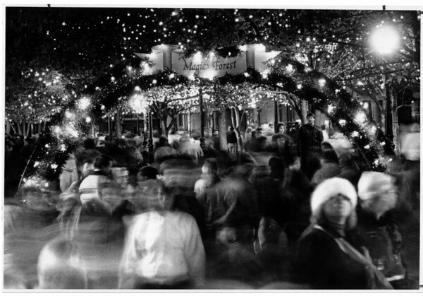 Christmas - Festival of Lights<br /> Old Falls Street takes on a festive atmosphere after the official 1990 - 1991 opening.<br /> Here a time exposure of 15 second shows the streaming crowd entering Old Falls Street from Lackey Plaza.<br /> Photo - By James Neiss - 11/24/1990.