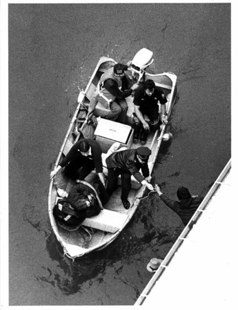 Niagara River - Rescues<br /> Susan M Salciccioli arriving at the Maid of the Mist boat landing by small boat after she fell into the gorge.<br /> Photo - By Ron Schifferle - 10/8/1985.