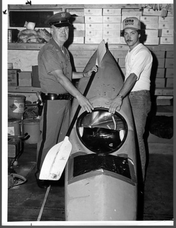 Niagara Falls, Stunters, Paul Weeden - Confiscated Kayak, stored in Niagar Frontier Parks Maint. garage on Goat Island. Lt. Arthur Woodhead, one of the arresting officers and Ed Olszewski, Maint. Supervisor at Garage. Andrew J. Susty photo - July 28, 1981