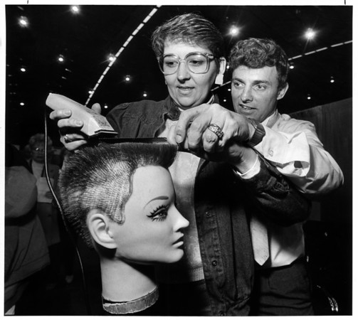 Convention Center - Bookings<br /> A flat top was the lesson for Teresa Houghtaling of Hornell, N.Y. a self employed beautician, by Kenny Alsup working for Andis Company, makers of clippers and Blades.<br /> Photo - By James Neiss - 10/30/1988.