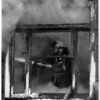Fires - Niagara Falls<br /> A Niagara Falls fighter battles a blaze inside of a home at 1349 South Ave. <br /> Photo - By James Neiss - 1/8/1992.
