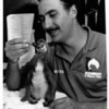 Atractions - Aquarium<br /> Aquarium of Niagara Falls.<br /> Hand feeding, a Peruvian Pnguin Chick hatched at the Aquarium, now weighing 3 pounds. Senior Aquarist Glen LaPlaca hand feeds fish to the penjuin.<br /> Photo - By Ron Schifferle - 6/22/1990.