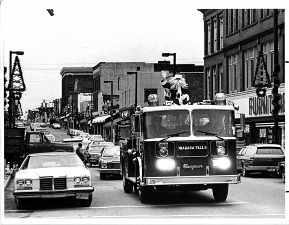 Christmas - Niagara Falls Fire Department<br /> Santa coming down Main Street near Niagara Ave.<br /> Photo - By John Kudla - 12/1/1984.