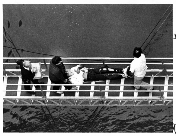 Niagara Falls - Rescues<br /> Richard J. Weslowski being carried from the Maid of the Mist boat landing where he was brought by boat after he fell into the Gorge.<br /> Phot - By Ron Schifferle - 10/8/1985.
