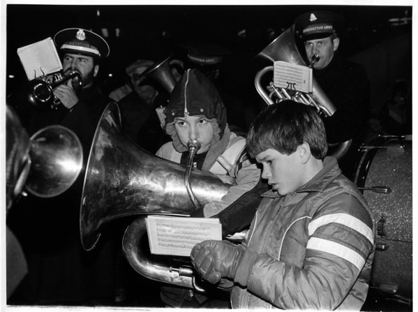 Christmas - Festival of Lights<br /> Rick Potter age 12 - Tooting and Doug Hale age 11 - holding Members Salvation.<br /> Army Band<br /> Photo - By Joe Eberle - 11/27/1982.