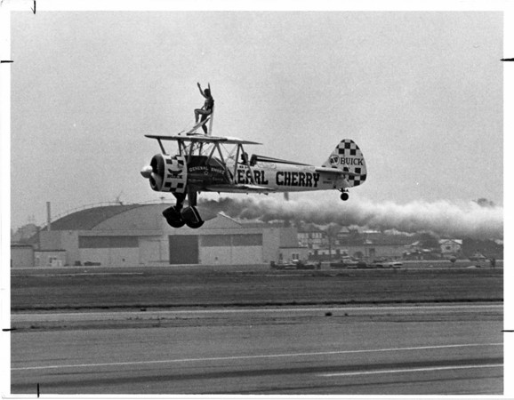 Airplanes - Airshow<br /> Earl - pilot and Paula - wing walker Cherry, practice at the Niagara Falls Airport for the airshow. The Niagara Falls Air Base is in the background.<br /> Photo - By John Kudla - 7/10/1985.