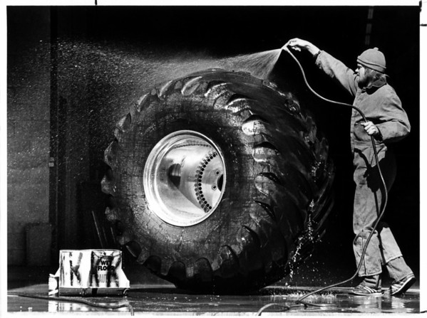 Convention Center<br /> Bog Wheel<br /> Karl Carlson of Houston, Texas has a big job cleaning a wheel from King Krunch a monster truck that will compete at the Niagara Falls Convention and Civic Center.<br /> The tire is 5.5 feet tall and 4 feet wide.<br /> Photo - By Ron Schifferle - 3/21/1985.