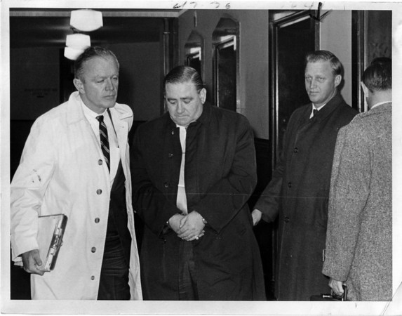 Police - Mafia Crime Lord.<br /> Magadino handcuffed possibly outside court room.<br /> Photo - By Niagara Gazette - 11/27/1968.