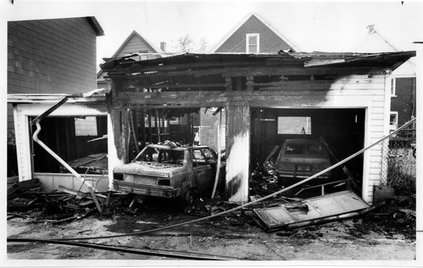 Fires - Niagara Falls<br /> Garage Fire behind 445 Ninth Street about 4:00am.<br /> Photo - By Ron Schifferle - 6/27/1991.