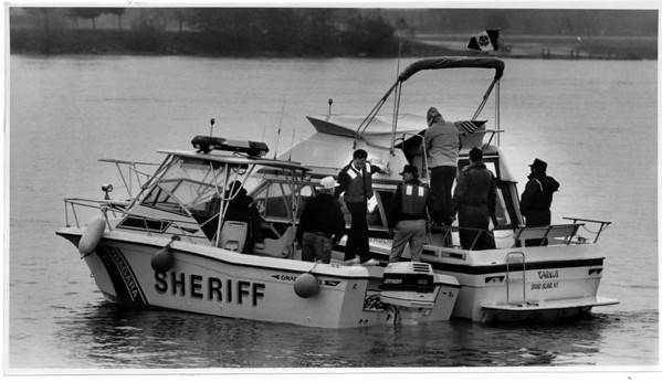 "Police - Niagara County Sheriffs Boat Boardsanother during a ""practical Boarding Exercise"", on the Niagara River just off the Niagara Yacht Club on River Rd. in North Tonawanda<br /> Photo - By James Neiss 5/17/1990."