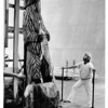 Convention Center - Bookings<br /> Thomas Penney Watches his work of art, an 11 foot, 3000 pound bear loaded on a plat form at the Niagara Falls Convention Center. The bear was carved from a log using a chain saw.<br /> Photo - By Ron Schifferle - 8/22/1983.