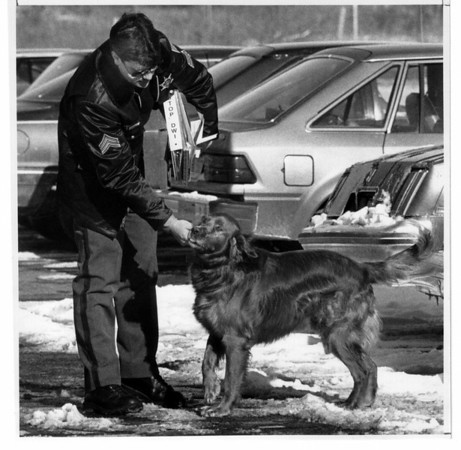 "Police - Niagara county Sheriffs Mascott.<br /> Sgt. Christopher J. Carlin is greated in the sheriffs parking lot by ""Scotch"".<br /> Photo - by James Neiss 1/14/1991."