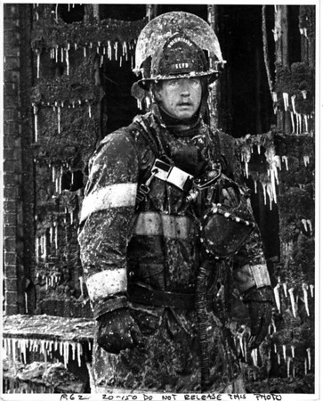 Fires - Lockport<br /> Bowen Road, Lockport - Chris Dietz Home.<br /> -37 degrees Farenheit wind chill factor makes South Lockport Volunteer firefighter Bob Hamilton, exhausted after battling the fire seem frozen like a statue as he pauses - perhaps with warmer thoughts on Christmas Eve.<br /> Photo - Bu Bukaty - 12/24/1983.