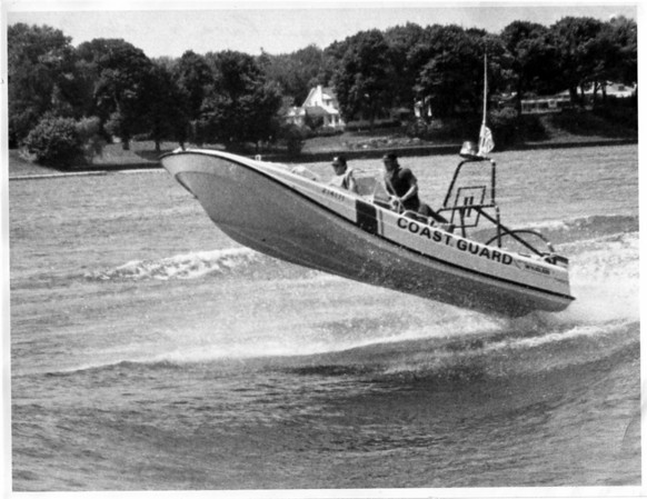 Coast Guard - Lower Niagara River<br /> Patrolling the Lower Niagara River and Lake Ontario Waters.<br /> U.S. Coast Guard 21 foot search and rescue launch - with 70 horse power motor.<br /> The picture shows the boat crossing a 4 foot wake.<br /> From left to right - Boatswains mate 3rd class Dan Walther and Boatswains mate 3rd class Sergio Cardenas - at comtrol wheel.<br /> Photo - By Andrew J. Susty - June 1979.