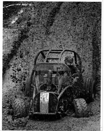 "Convention center<br /> The Mud Man<br /> Mark Moncalain ""The Mud Man"" went 32 feet 10.75 inches came in 10th place.<br /> Photo - By James P. McCoy - 1/13/1985."