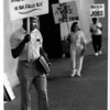 Organizations - Niagara Improvement Association.<br /> Eddie Palmore President of Niagara Improvement Association pickets in front of the Niagara Falls Convention Center, where the free trade meetings are being held, to demonstrate for a Martin Luther King Jr. Day in Niagara Falls.<br /> Photo - James Neiss - 6/8/1989.