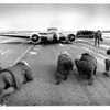 Airplane - Cargo Plane<br /> The media coverage on the landed plane at Niagara Falls Airport. This cargo plane's landing gear failed to work and it made an emergency landing.<br /> Photo - By Elisa Olderman - 12/20/1981.